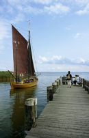Zees Boat leaving  Ahrenshoop Althagen harbour, Germany.