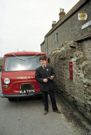 Postman collecting from village post office in the late 70's