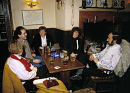 Group of people enjoying a relaxing evening in a country Pub, Wiltshire, UK. ca 1990.