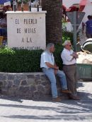 "Two Spaniards having a ""chin wag"" in the shade!, Mijas"