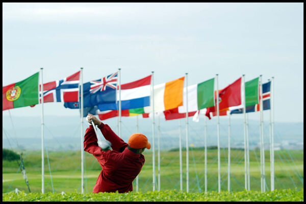 A golfer drives off during the Senior Master competiton at Royal Troon