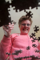 Photographed for a social service brochure illusrating case studies in this example the lady had a passion for jigsaws