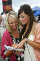 Two ladies study the form at Ayr racecourse