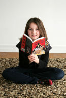 Young girl who was 400th member of Millport library. Taken for North Ayrshire Council