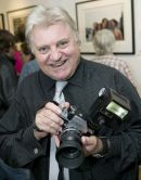 529X0851              Beatles photographer Tom Murray with the camera he used to photograph The Beatles