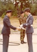 Sq Ldr Halstead WESCCF and Lt Peter Evans RRW making presentation to Cadet WO Paul Calcott probably at St Martin's Plain or Crowborough c.1975