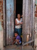 Mother & son in doorway, Bayamo