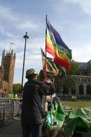 Brian Haw holds the flag of peace