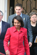 Condoleezza Rice leaves secret meeting
