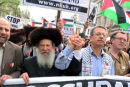 Hochhauser Orthodox Jew marches hand in hand with Dr. Mustafa Barghouthi Secretary General MP Palestinian National Initiative for peace.