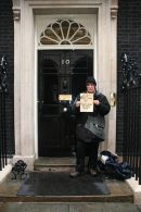Maria Gallastegui takes a petition to Gordon Brown